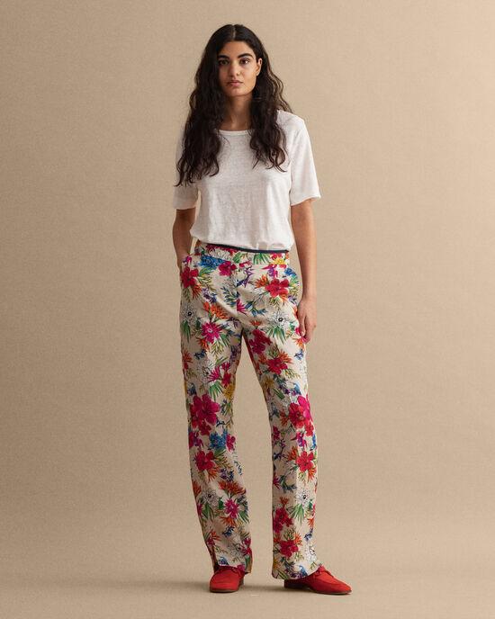 Humming Floral Hose mit ausgestelltem Bein und Print